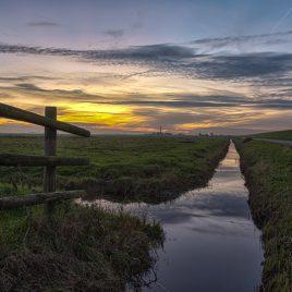 Arkemheen polder met Stoomgemaal Hertog Reijnout zonsondergang